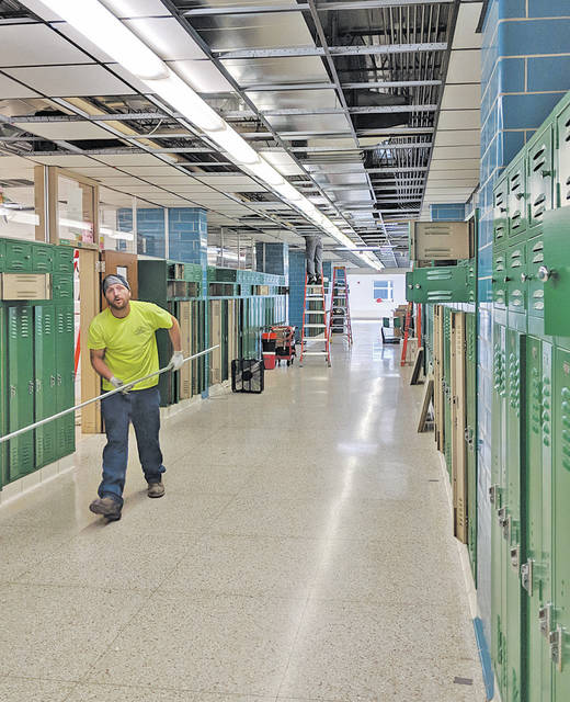 Workers are installing air ducts to cool Amherst Steele High School, where late spring and early fall temperatures can make some rooms brutally hot.