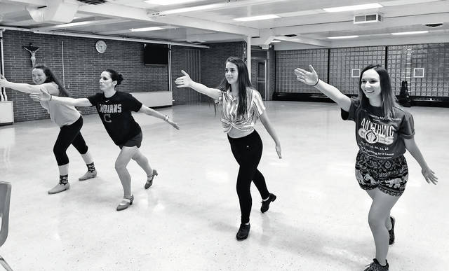 """Robin Terschak of Vermilion, Melissa Anderson of Amherst, Regina Wolf of Amherst, and Marianne Ference of Amherst rehearse their steps for """"Anything Goes."""""""