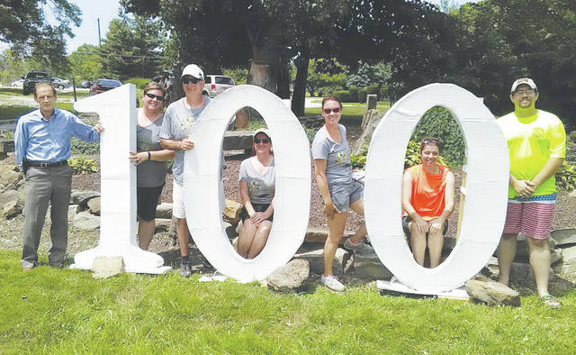 South Amherst mayor Dave Leshinski and park board members Sara Lalonde, Zoltan Zoltai, Laurie Beran, Jerileigh Siss, Jessie Beran, and Tyler Paterchak welcome residents Saturday to a centennial picnic.