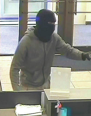 This surveillance camera shot shows a suspect in a ski mask Monday at Chase Bank at the corner of Rt. 58 and Cooper Foster Park Road.