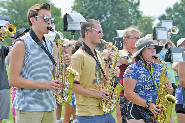 Shane Scheffer, Ethan Cooper, and Jewelia Houghtland play their hearts out on the Steele High School practice field under the direction of Christopher Barbaro.