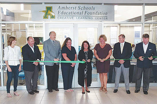 Members of the Amherst board of education and educational foundation cut the ribbon Aug. 21 on a new creative learning center at Amherst Junior High School.