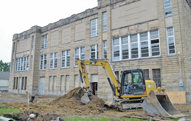 Earth is being cleared at the rear of the former Central School. Construction is expected to last 16 months but several decisions remain to be made — for example, whether to unbrick the original windows seen on here on the upper level. Sprenger Healthcare COO Michael Sprenger said he hopes to restore the original windows if doing so will not compromise the structure.