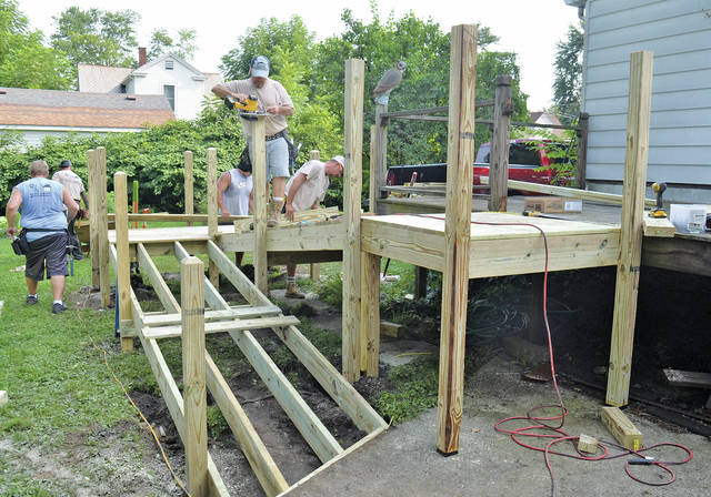A crew from UAW Ford builds a new ramp on Middle Street for a Korea veteran.