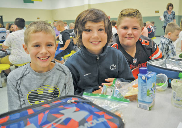 Fifth-graders Matthew Walker, Aiden Bindas, and Grant Taylor have a blast at Nord Middle School.
