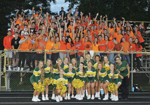 """Students excited for the start of football season join with 16 cheerleaders to get loud at the opener. Fans were encourage to wear orange to support Todd """"Bubba"""" Engle, who taught health and physical education at Nord Middle School."""