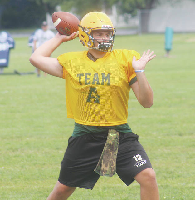 Comets quarterback Matt Fairchild winds up his release during practice. Amherst kicks off its season Aug. 24 on the road at Clearview.