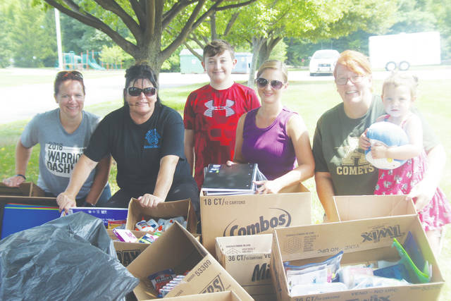 Regan Carpenter, Jennifer Layfield, Mason Cawthon, Dawn Clappas, Heather Hatten, and Henley Hatten organize donated school supplies Aug. 12 during the Amherst police department's 'cram the cruiser event.