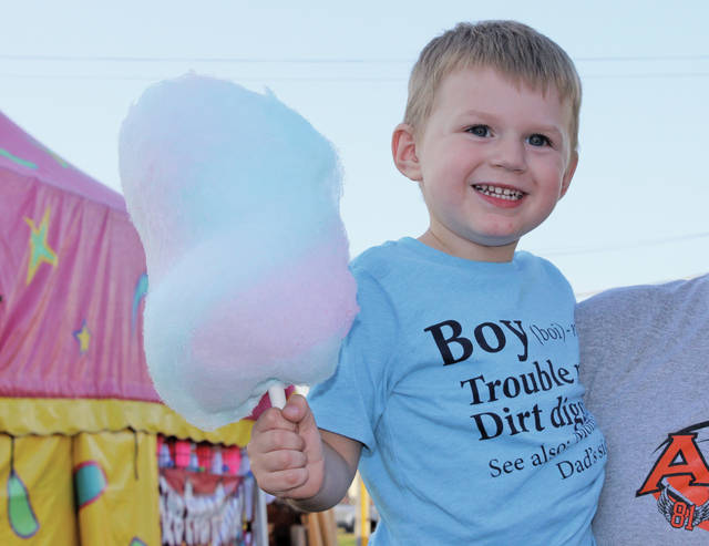 Look at the size of that cotton candy! Joseph Markle of North Ridgeville is prepared for a sugar rush.