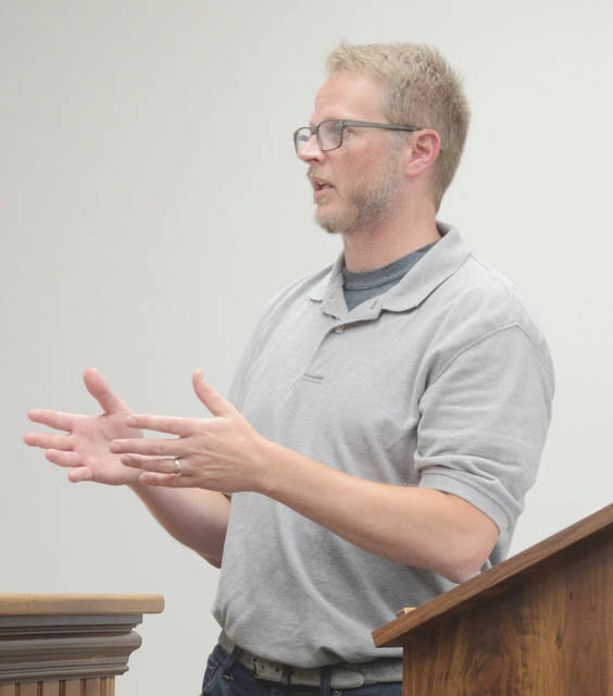 Resident John Ritter questions utility bill totals during Monday's Amherst city council meeting.