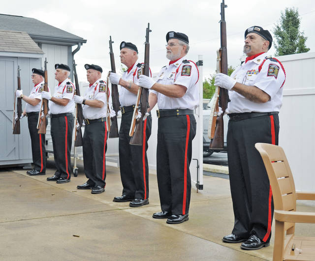 Honor guard members prepare to fire a volley in remembrance of those lives lost on Sept. 11, 2011, and in the wars fought by American service members.