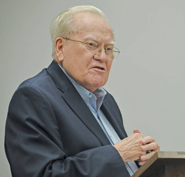 Former Amherst mayor David Taylor speaks Sept. 24 following passage of a city council resolution in his honor.