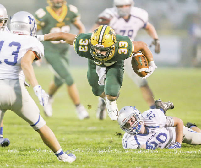 Danny Makruski gets tripped up and is sent flying after a big gain Friday versus Midview.