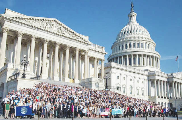 More than 1,000 Citizens' Climate Lobby volunteers gather on the Capitol steps.