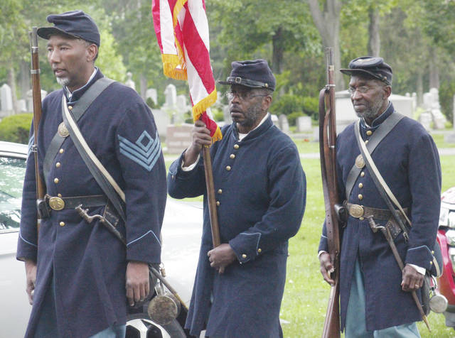 Members of the 5th United States Colored Troops take part in this year's Maafa memorial service at Westwood Cemetery.