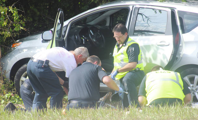 First responders give CPR to Albert Salzer of Oberlin after a medical episode caused him to crash his car in Pittsfield Township.
