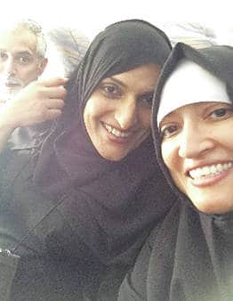 Fawzia Gilani-Williams and her friends Mohammed and Zuleikha snap a photo on a plane to Saudi Arabia.