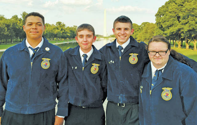 Visiting the Washington Monument are Lorain County JVS FFA members Marquis Walker (Oberlin), Jesse Everson (Elyria), Don Sabella (Amherst), and Jessica Mileski (Wellington).
