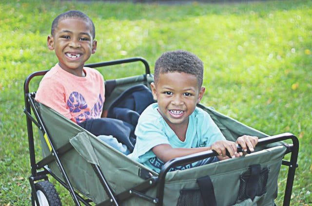 Brothers Owen and Aiden Jackson stroll into Park Street Park, eager to see the police officers they met at Safety Town.