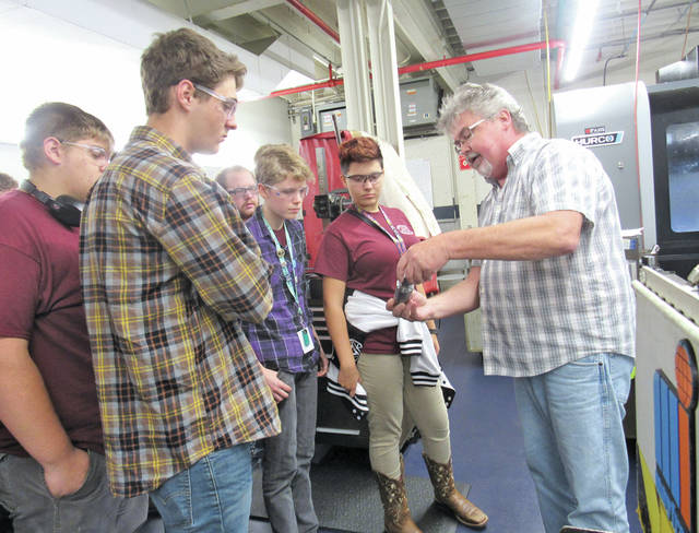 Dale Stumphauzer, EMC customer service, gives a plant tour to Lorain County JVS students.