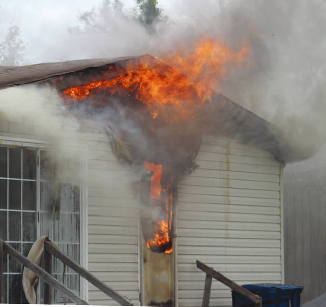 Flames erupt Oct. 5 from an East Hamilton Street home. The blaze caused no injuries but the home has been declared uninhabitable by firefighters.