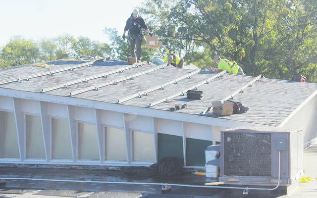 Thirty-six solar panels will line the roof of First Church's fellowship hall.