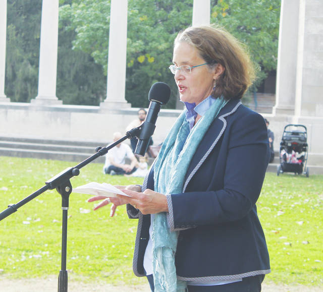 Ann Sherif hosts the dedication of a tree that survived the A-bomb's decimation of Hiroshima, Japan. It is now located on Tappan Square.