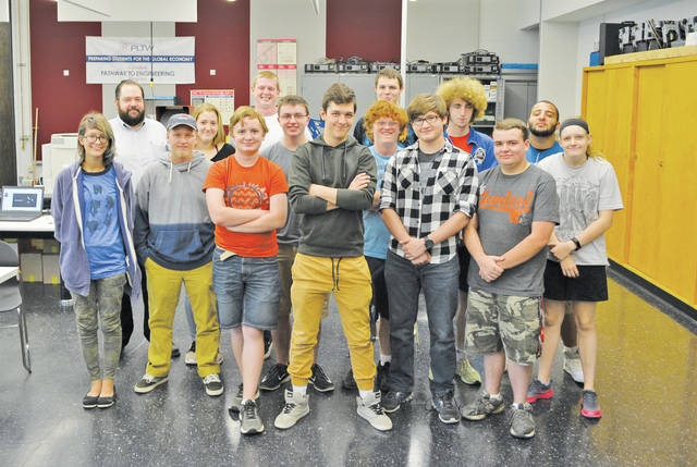 Project Lead the Way seniors pose with Lorain County JVS instructor Brian Iselin.