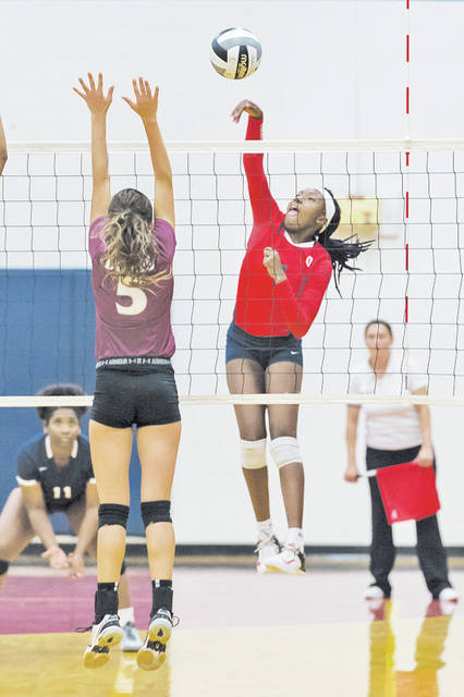Oberlin's Kayliana Barbee hits the ball down the line for a point against Wellington.