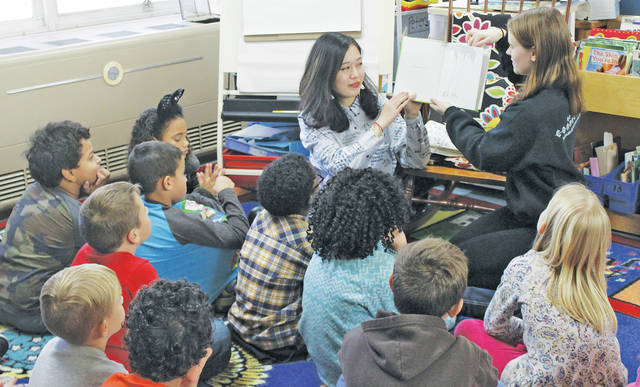 "Oberlin College students Cleo Hu and Emily Strand read ""The Giving Tree"" to Michele Peter's second grade classroom."