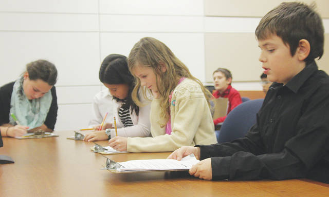 Prospect students Sydney Robinson, Maia Tritt, Ella Skvor, and Daylon Mason prepare their case Dec. 8 in this year's Lorain County mock trial.