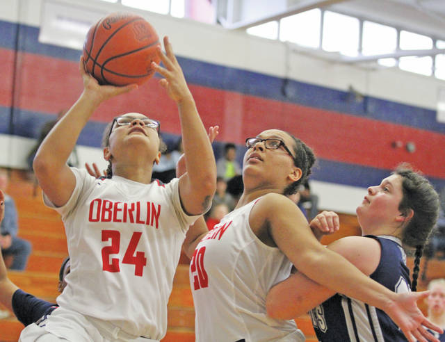 Kiah Fields goes to the hoop with the help of a block from Karissa Rankin.