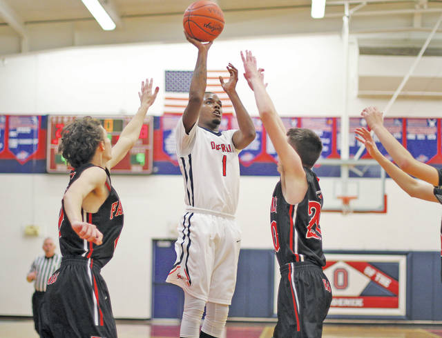Justin Smith hits a jumper in Friday's overtime showdown against Fairview.