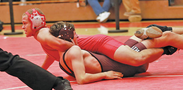 Reggie Bouchonville works for a pin. He was injured early in the Cuyahoga Heights tournament but is expected to return to the mats this Saturday.