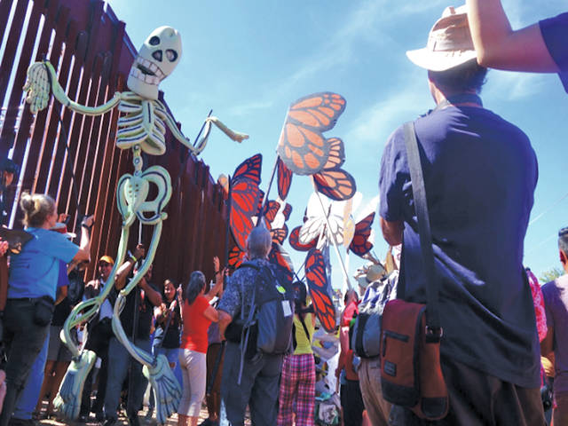 A scene from the protest at the U.S.-Mexico border organized by School of the Americas Watch last fall. Many border studies students participated in a puppet show put on by the Bread and Puppet Theatre, celebrating solidarity with migrants and refugees on both sides of the border wall in Nogales, Ariz., and Nogales, Sonora.