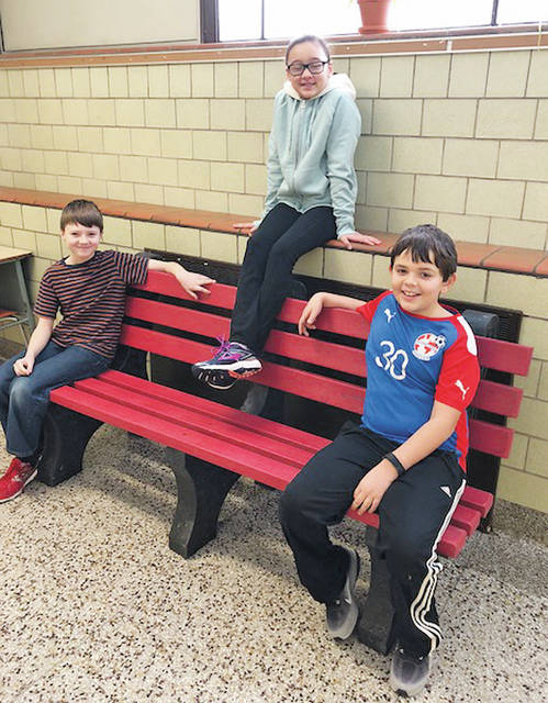 Prospect Elementary School students sit on benches made from more than 1,200 pounds of recycled bottle caps.