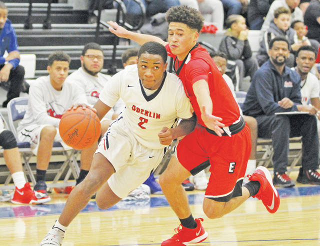 Devan Yarber goes inside, battling the Pioneers during the Lorain County Holiday Classic.