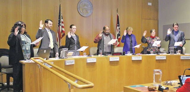 Oberlin city council members renew their oaths of office with guidance by law director Jon Clark.