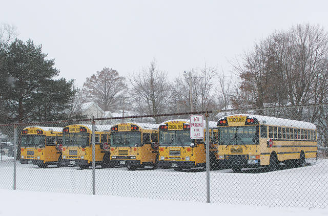 Oberlin's bus fleet sits unused during a week of canceled classes due to extreme cold.