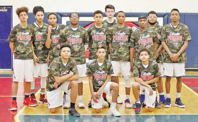 Phoenix boys hoop stars pose in their Military Appreciation Night gear prior to their game against the Brooklyn Hurricanes.