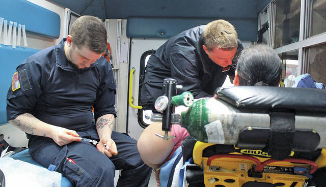 LifeCare Ambulance paramedics Andrew Harmon and Zack Tomasic administer a pain reliever to a patient while we ride along and discuss Lorain County's drug epidemic.