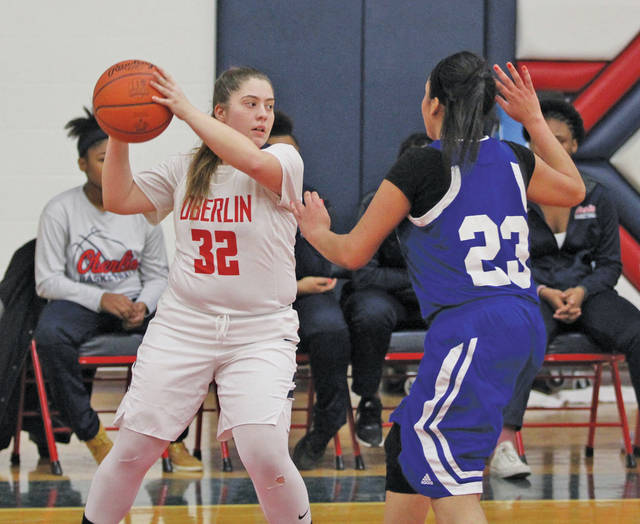 Oberlin's Danielle Amato looks for a teammate while under guard.