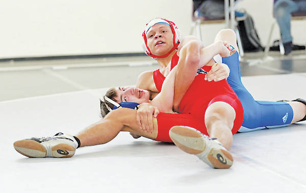 Reggie Bouchonville, wrestling at 132 pounds for the Phoenix, uses a headlock for a pin during the Vermilion Holiday Super Duals.