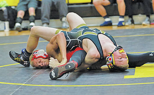 Robert Bouchonville works for the pin in Phoenix wrestling action.