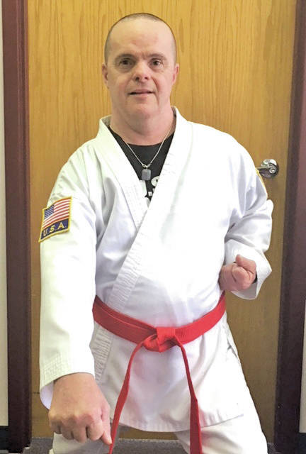 John Hall, who takes part in the adult program at Oberlin's Murray Ridge center, has earned an honorary red belt.