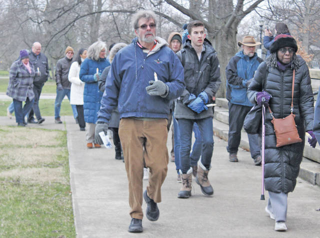 About 150 people walk from Tappan Square to First Church in Oberlin to remember the life of the Rev. Martin Luther King Jr.