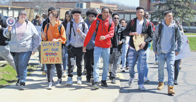 Students walk out of Oberlin High School April 20 to protest gun violence, joining others nationwide on the anniversary of the Columbine massacre.