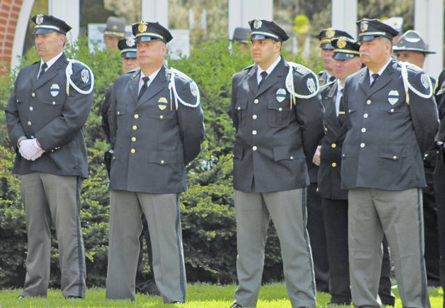 Det. Marc Ellis, Sgt. Steve Chapman, Ptl. Bashshar Wiley, and Ptl. Ray Feuerstein represent the Oberlin police department at the Lorain County Police Memorial in Wellington.