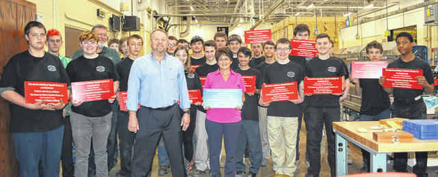 Instructor Eric Robson and his ninth-graders at the Lorain County JVS show off signs with Operation Rescue's David Gantz and Marsha Norberg.