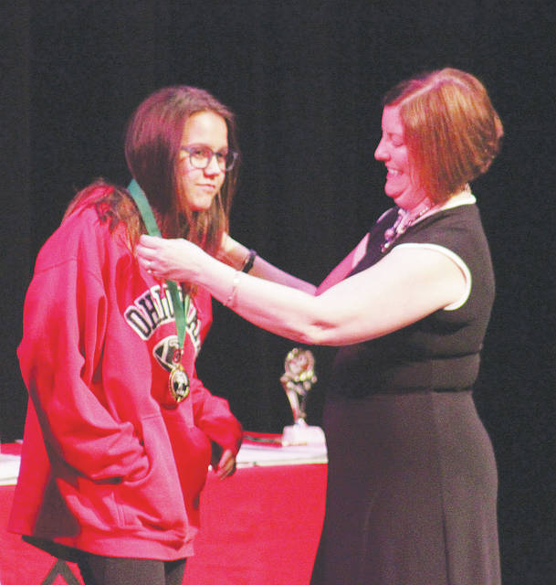 Oberlin's Mercy Shuck receives a nomination medal for artwork May 16 during the Lorain County Young Authors Conference at LCCC.